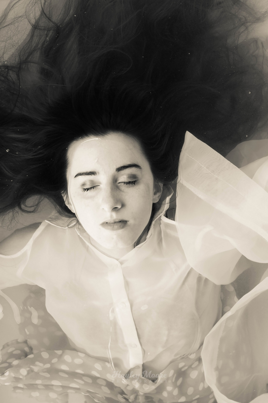 Girl In Water with drapes at peace