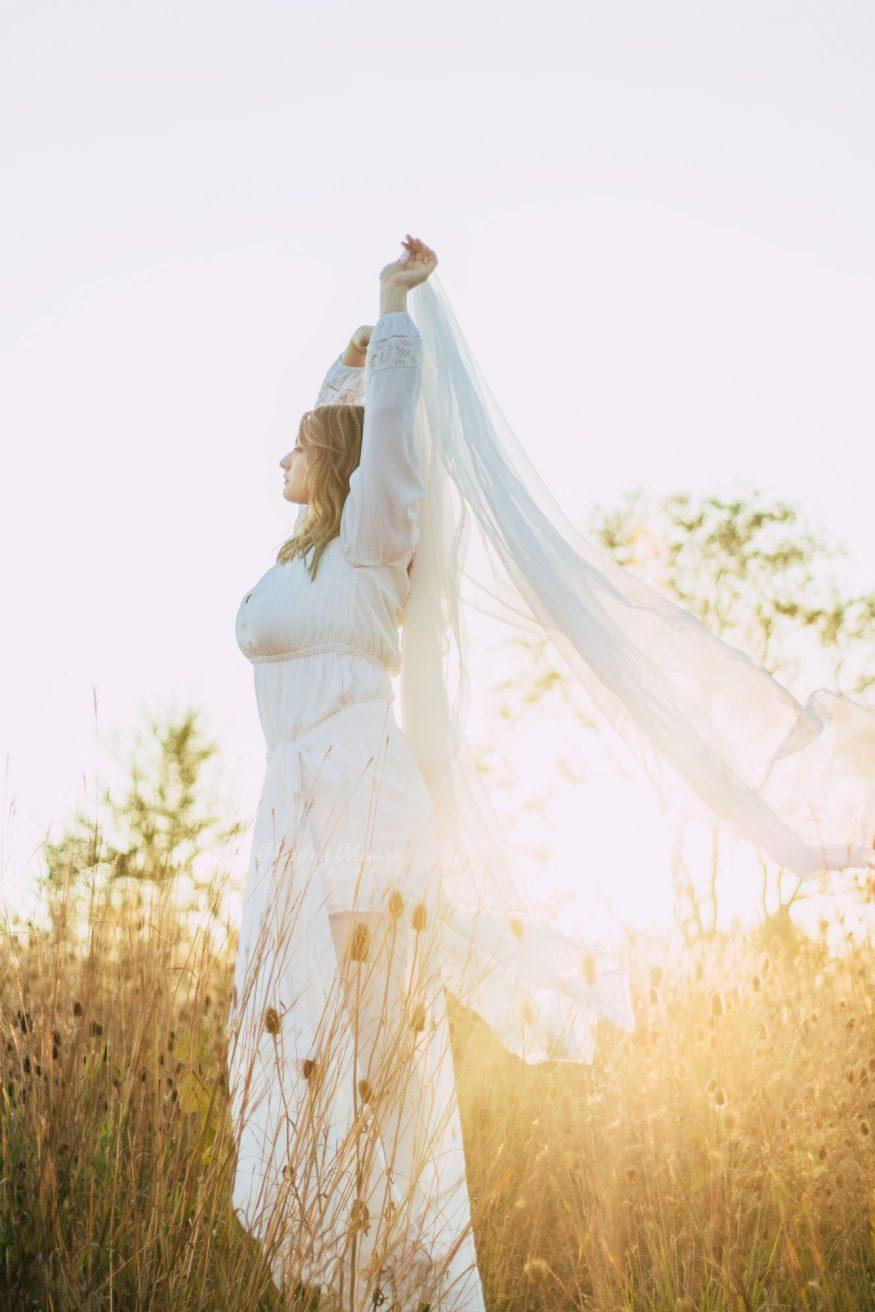 Portrait of a woman in field