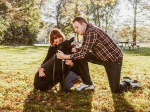 Mother and son with black lab