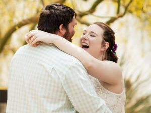 portrait of couple laughing in gardens